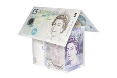 房子挣了货币 免版税库存照片