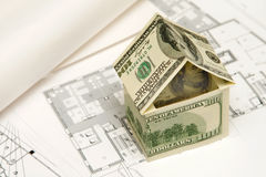 房子挣了货币 库存图片