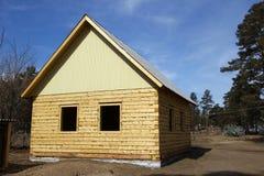 房子日志新的正方形 免版税图库摄影