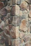 房子的壁角结构 纹理-人为装饰石头façade 灰色颜色概略的石墙背景纹理 图库摄影