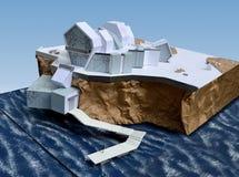 房子的模型一个岩石的由海 库存图片