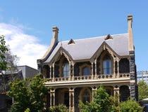 房子的烟囱和阳台 免版税图库摄影