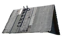 房子的老屋顶 在屋顶的梯子 奶油被装载的饼干 免版税库存照片
