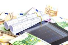 房子的金钱和片剂计算机 免版税库存图片