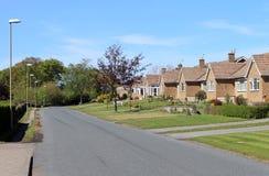 房子行英国街道的 免版税库存照片
