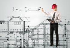 画房子计划的一位年轻建筑师 库存照片