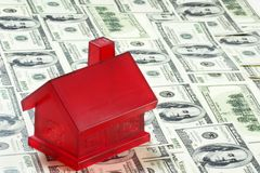 房子货币红色 库存照片
