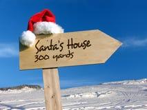 房子s圣诞老人路标 库存照片