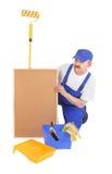房屋油漆工和corkboard 图库摄影