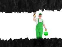房屋油漆工盖在黑色的无形的墙壁 图库摄影
