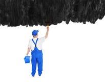 房屋油漆工从后面盖子无形的墙壁 免版税库存图片