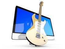 所有在有吉他的一台计算机 免版税库存照片