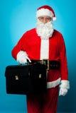 所有设置圣诞老人访问他新的办公室 免版税库存图片