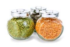 扁豆不同在三个瓶子 库存图片