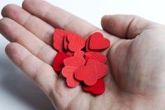 手中全部红色心脏 库存图片