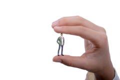 手中小雕象式样的人 免版税库存照片
