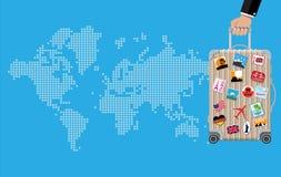 手中旅行的袋子 在轮子的台车 免版税图库摄影