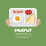 手中早餐的盘子 库存照片