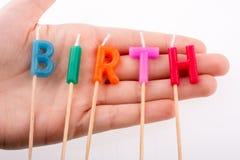 手中生日的蜡烛 免版税库存图片