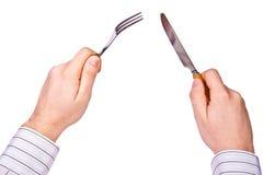 手中的叉子和的刀子 库存图片