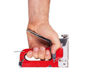 手中钉书针的枪 免版税库存照片