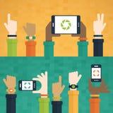 手举与移动设备 免版税库存照片