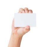 手举行卡片被隔绝的裁减路线里面 免版税库存照片
