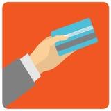 手举行支付的信用卡 库存例证