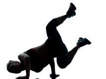 手倒立妇女锻炼 免版税库存照片