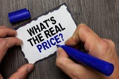 手写文本什么s是真实的价格问题 概念意思给物产或企业灰色木甲板韩的实际价值 免版税库存图片