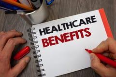 手写文本医疗保健好处 意味它的概念是包括医疗费用笔记薄笔信息ide的保险 免版税库存照片