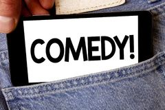 手写文本喜剧电话 概念意思乐趣幽默讽刺情景喜剧欢闹耍笑的娱乐笑的人举行固定的单元 免版税库存图片