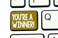 手写文本您关于是优胜者 赢取作为第1个地方或冠军的概念意思在竞争中 免版税库存图片