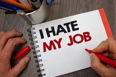 手写文本我恨我的工作 恨您的位置的概念意思烦恶您的公司坏事业笔记薄笔信息ide 库存照片