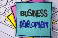 手写文本文字业务发展 概念意思开发并且实施组织书面的成长机会  免版税库存照片