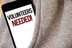 手写文本文字志愿需要的诱导电话 意味社会公共慈善志愿主义树冰col的概念 免版税库存图片