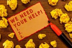 手写文本文字我们需要您的帮助 概念意思服务协助支持用好处助手格兰特 免版税库存图片