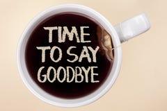 手写文本文字时间说再见 概念意思留下终止告别的分离片刻祝愿书面的结尾  库存照片