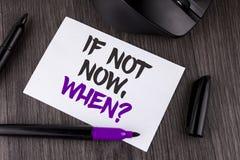 手写文本文字,如果不现在,当问题时 概念意思询问投入计划的时间做在白色Stic写的名单 免版税图库摄影