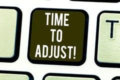 手写文本时间为做调整继续向前键盘键调整意味正确的片刻的概念 免版税库存图片