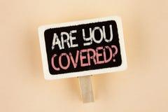 手写文本是您报道了问题 概念意思健康保险覆盖面在木通知写的灾后重建Bo 免版税库存图片