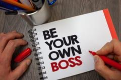 手写文本是您自己的上司 概念意思起动公司做自由职业者的工作企业家起动投资笔记薄笔informat 库存图片