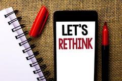 手写文本让我们重新考虑 概念意思给人时间认为事再改造在手机写的再设计o 库存图片
