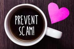手写文本防止诈欺诱导电话 概念意思消费者保护法欺骗交易抢劫咖啡可爱的tho 免版税图库摄影