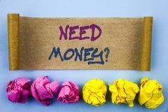 手写文本陈列需要金钱问题 意味经济财务危机,现金贷款的概念在稠粘的泪花需要写没有 图库摄影