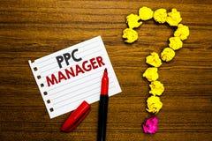 手写文本Ppc经理 登广告者每次支付费他们的广告一的概念意思是点击的纸标志弄皱 免版税库存图片