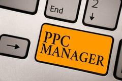 手写文本Ppc经理 登广告者每次支付费他们的广告一的概念意思是点击的键盘桔子钥匙 库存图片