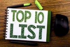 手写显示名列前茅10十的公告文本列出在笔记本笔访纸写的成功十名单的企业概念o 免版税库存照片