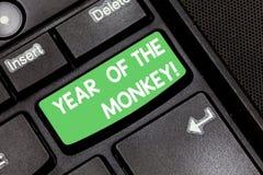 手写猴子的文本年 概念意思中国占星中国传统庆祝键盘键 免版税库存图片