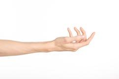 手势题材:在白色背景显示姿态隔绝的人的手在演播室 免版税库存图片
